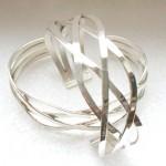 Zilveren armband. Gevlochten draden